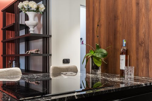 Hob built in table with bottle of liquor in kitchen