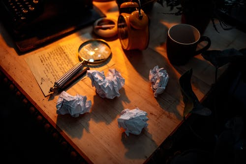 Crumpled Paper on the Wooden Table
