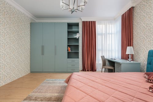 Modern bedroom interior with closet against bed in house