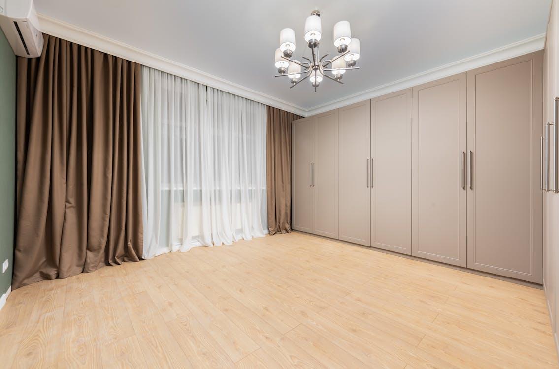 Closet on parquet under chandelier at home