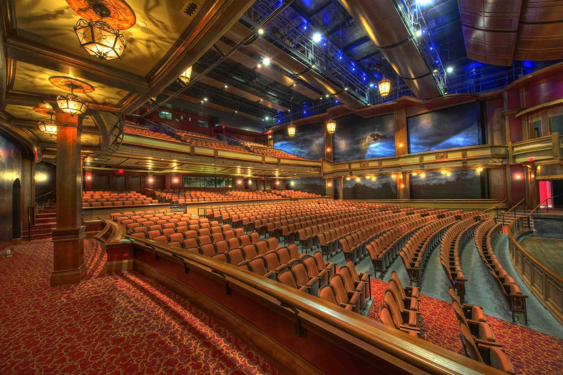 Orange Chairs Inside Theater Room