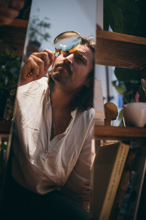 Man in White Button Up Shirt Drinking from Clear Glass Mug