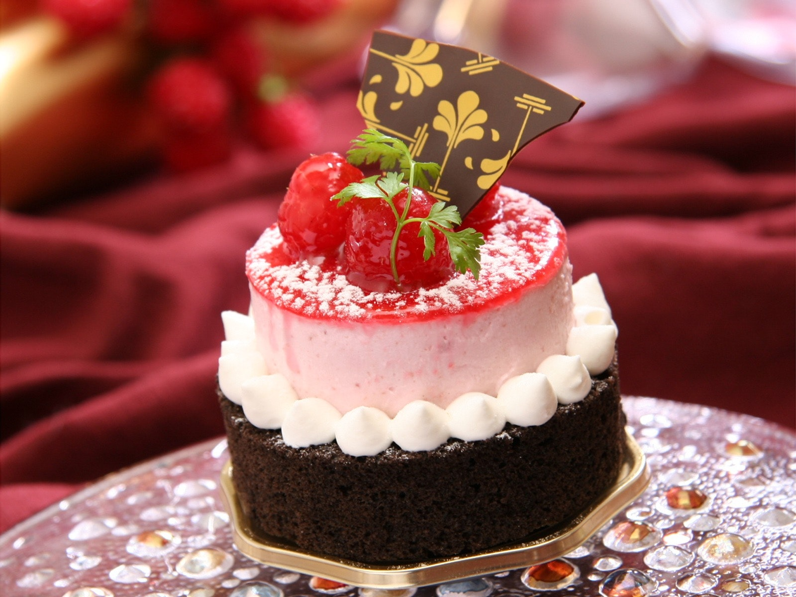 Chocolate Cake With White Icing And Strawberry On Top