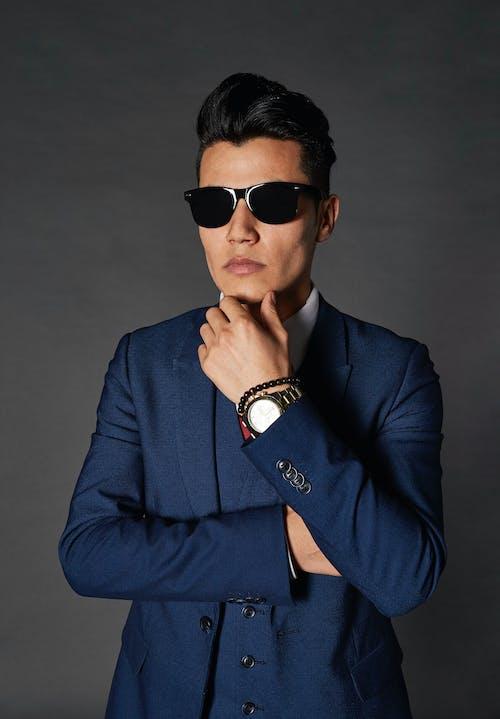 Man in Blue Suit Wearing Black Sunglasses