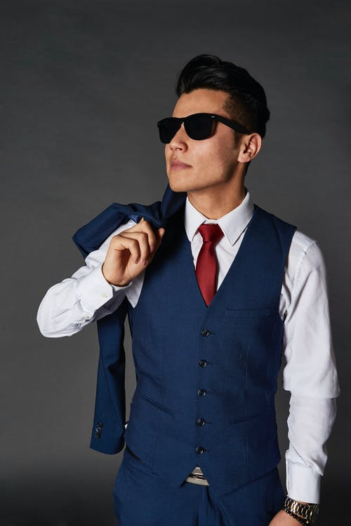 Man in Blue Vest and White Dress Shirt Wearing Black Sunglasses