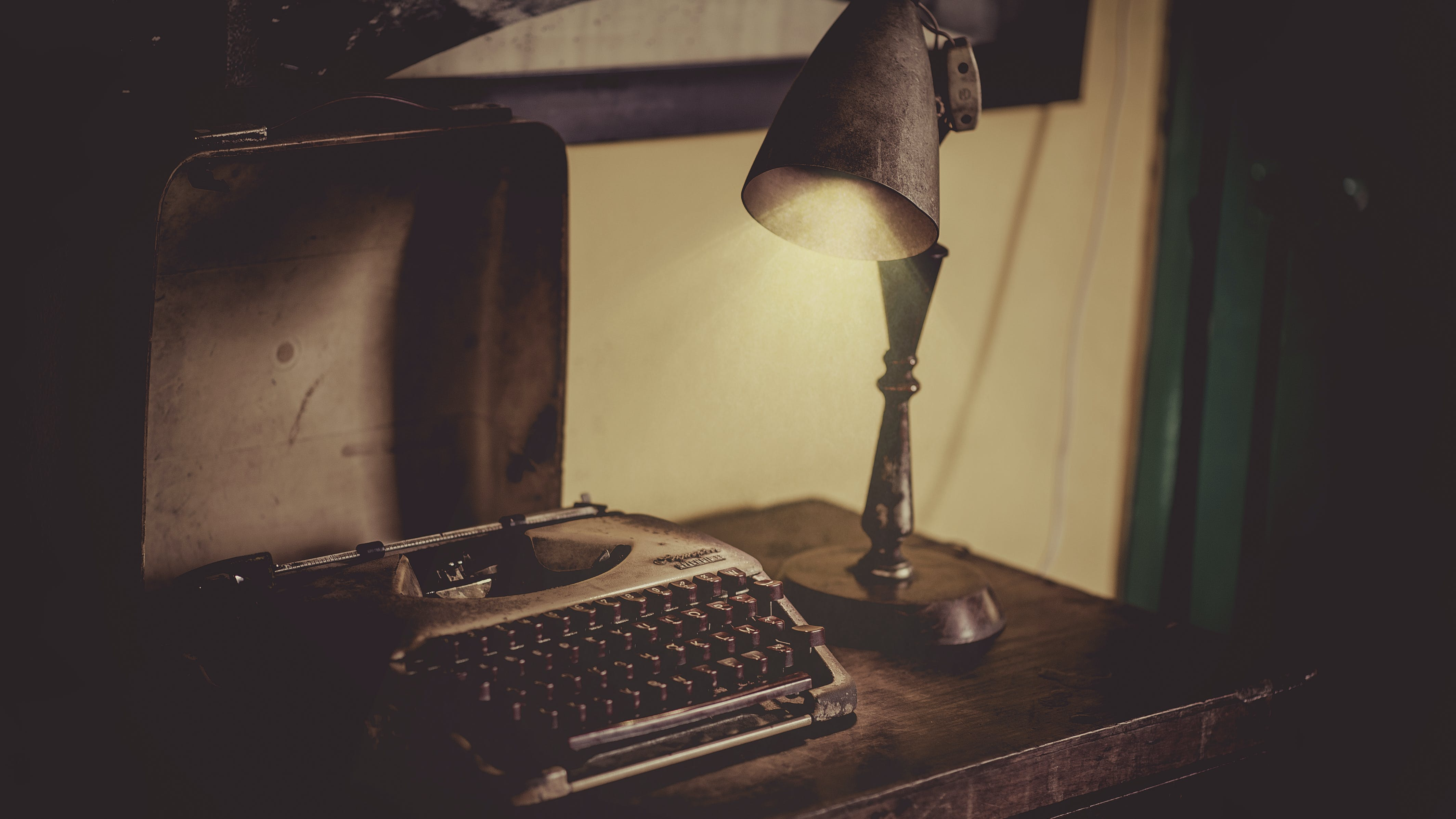 Sephia Photography of Desk Lamp Lightened the Gray Typewriter on Wooden Table