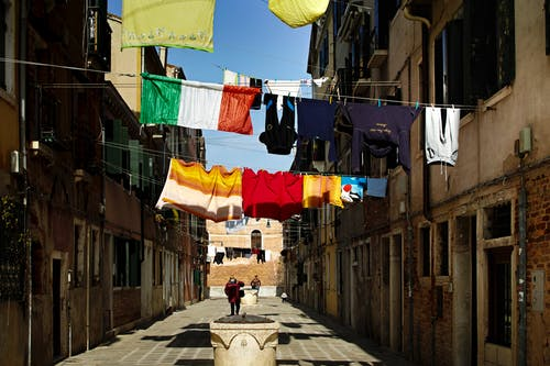 Clothes Hanging on Clothesline Along an Alley