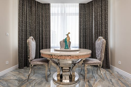 Dining room interior with statuette on table at home