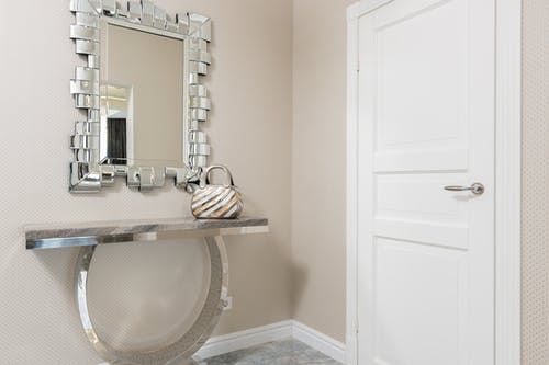 Mirror against entrance door in modern house