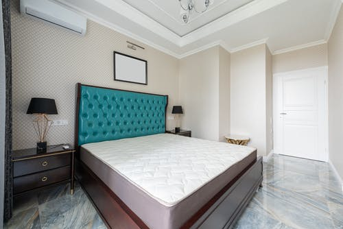 Contemporary bedroom interior with furniture on marble floor