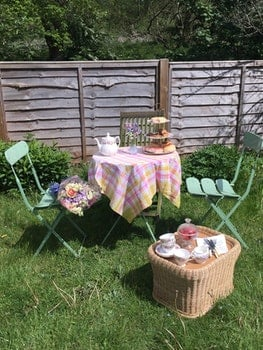 Pink and Yellow 3-piece Patio Set at the Green Grass