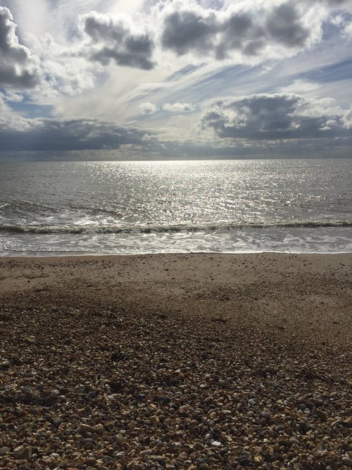 Free stock photo of clouds form, pebble beach, pebbles, sea