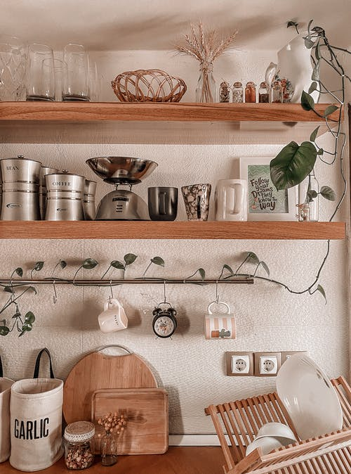 Stainless Steel Tea Pot on Brown Wooden Shelf