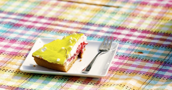 Yellow and Brown Pastry on White Saucer