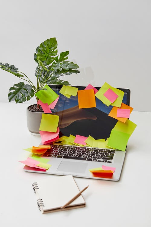 Colored Sticky Notes on a Laptop