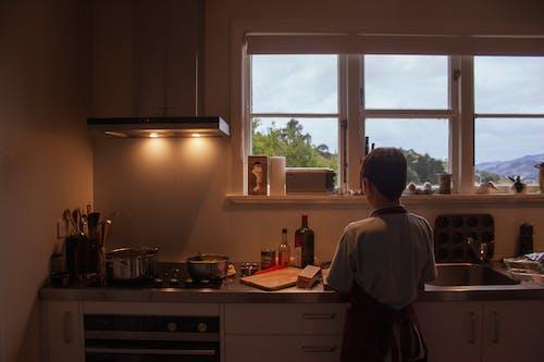 Man in White Shirt Standing in Kitchen