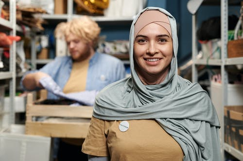 Woman in Gray Hijab Smiling