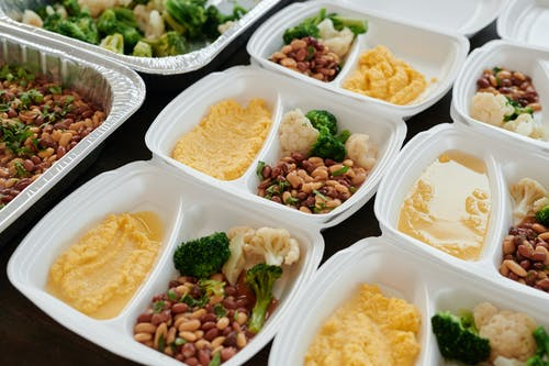 White Plastic Bowls With Food