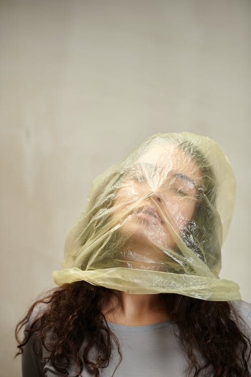 Person in Yellow Plastic Bag