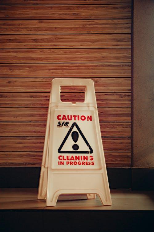 White warning sign on floor
