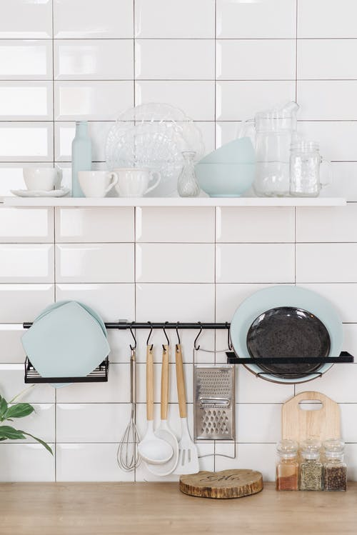 Kitchenware on White Wall and Wooden Table