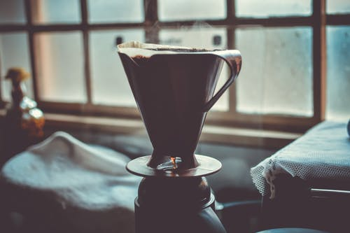 Black and Grey Ceramic Cup With Hot Coffee