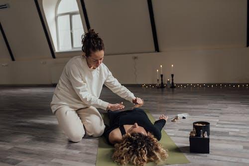 A Woman Performing Spiritual Healing Ritual