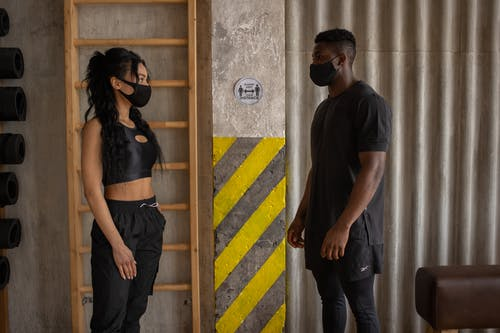 Female and African American male in medical masks