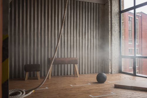 Battle rope and slam ball on floor in gym