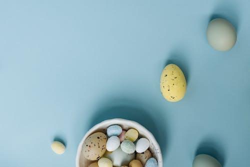 White and Brown Polka Dot Egg on White Ceramic Bowl