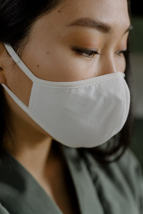Crop woman in medical mask