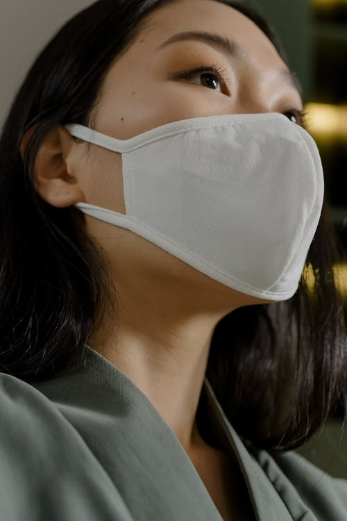 Woman in white sterile mask