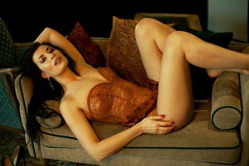 Alluring woman in lingerie on sofa