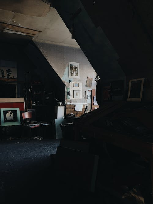 Modern art studio with paintings