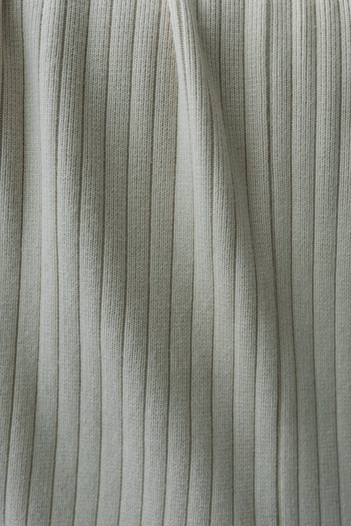 Gray striped fabric placed on table