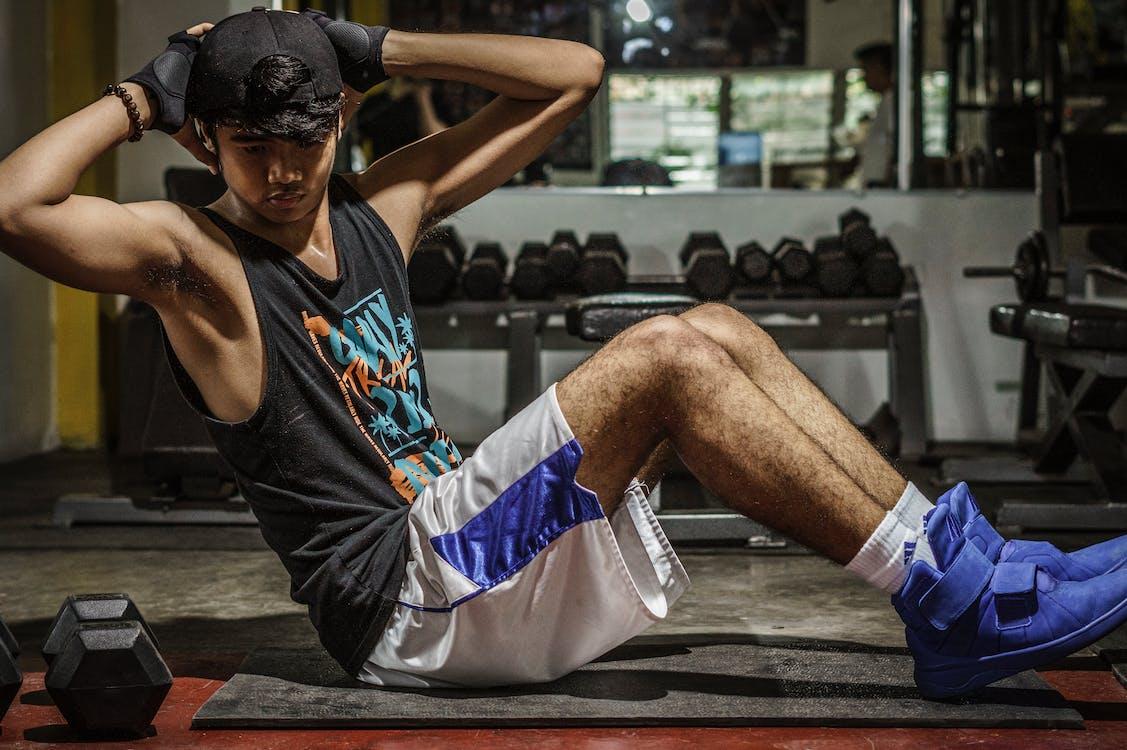 Man In Black Tank Top Inside Gym