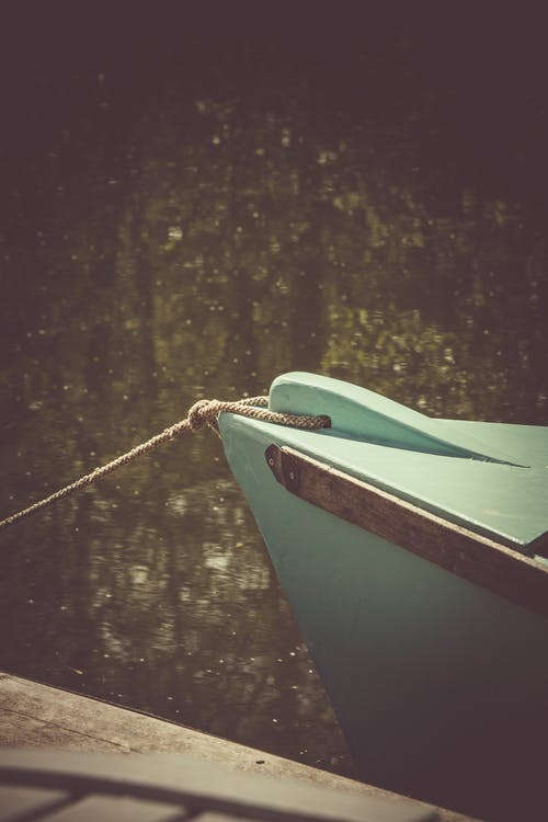 Teal Wooden Boat on Lake