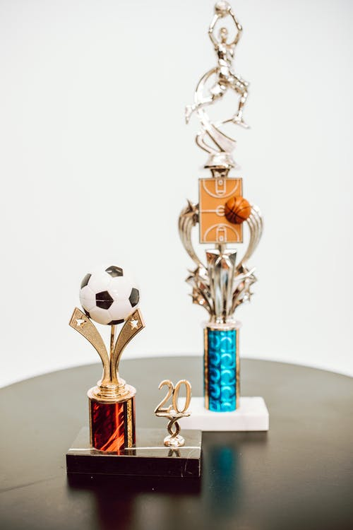 Gold and White Trophy on White Table