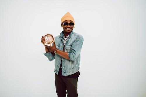 Man Holding a Music Award
