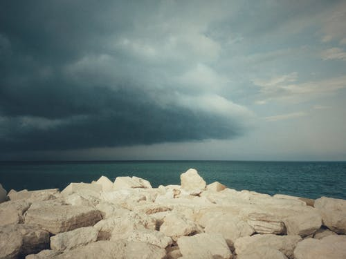 Photos gratuites de bord de mer, cailloux, ciel