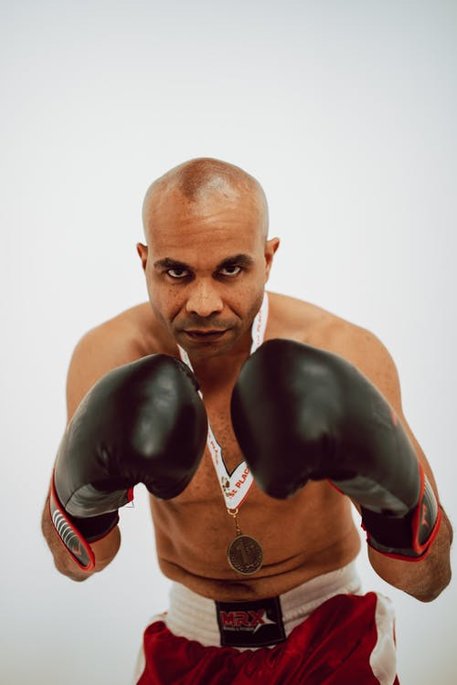 Man in Black and Red Boxing Gloves