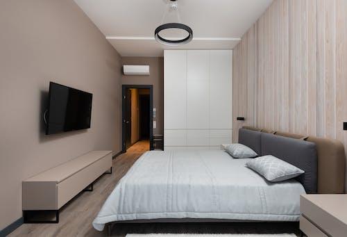 Modern bedroom interior with minimalist furniture and wooden parquet