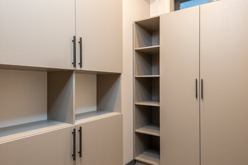 Minimalist styled wardrobe with empty shelves in room