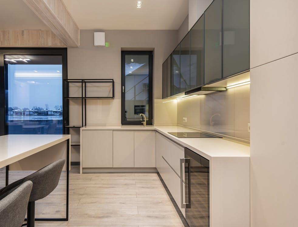 Interior of spacious kitchen with minimalist design in contemporary house