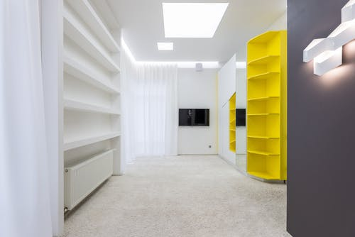 Interior of spacious empty room with new furniture and light walls in modern apartment