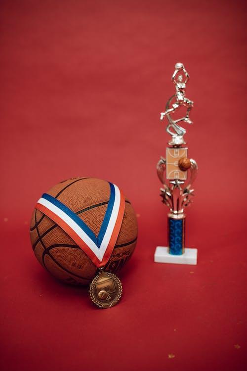 Brown Basketball on Red Basketball Ring