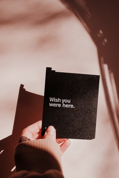 Person Holding Black and White Card