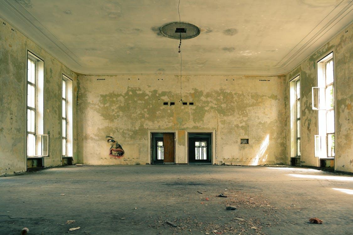 Brown Wooden Door Inside Abandoned Room