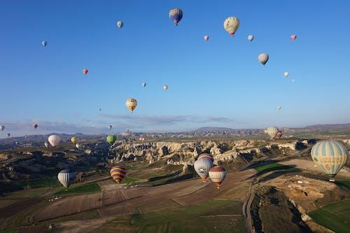 Hot Air Balloons Soaring Under Blue Sky