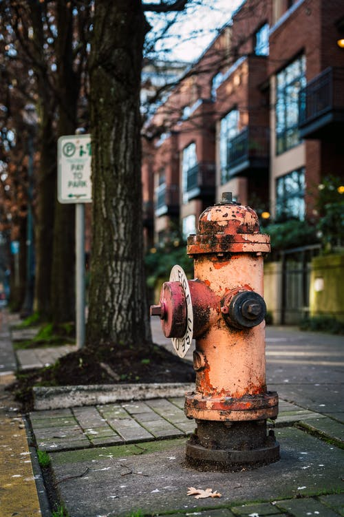 Brown and Gray Fire Hydrant on Sidewalk